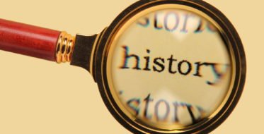 Old magnifying glass enlarged word history